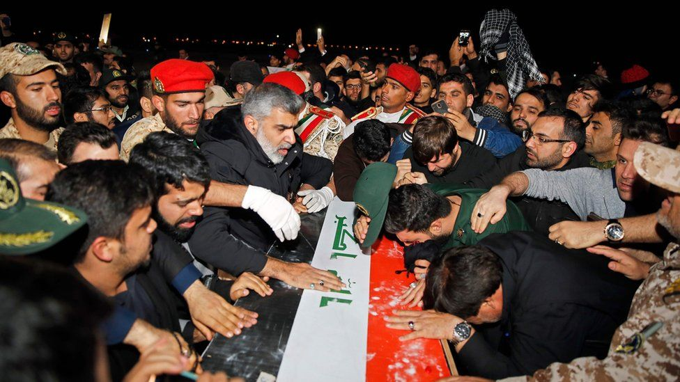 People carry the casket of Iranian commander Qasem Soleimani upon arrival at Ahvaz International Airport, January 5, 2020