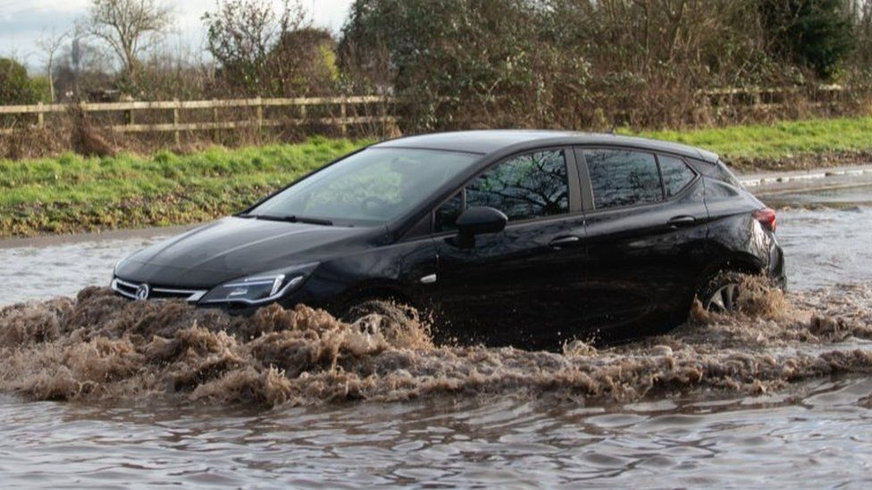 Car driving through floodwater in Hathern