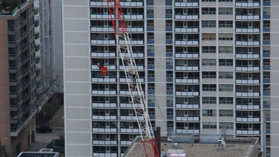 Toronto Fire Services rescue woman stranded on crane