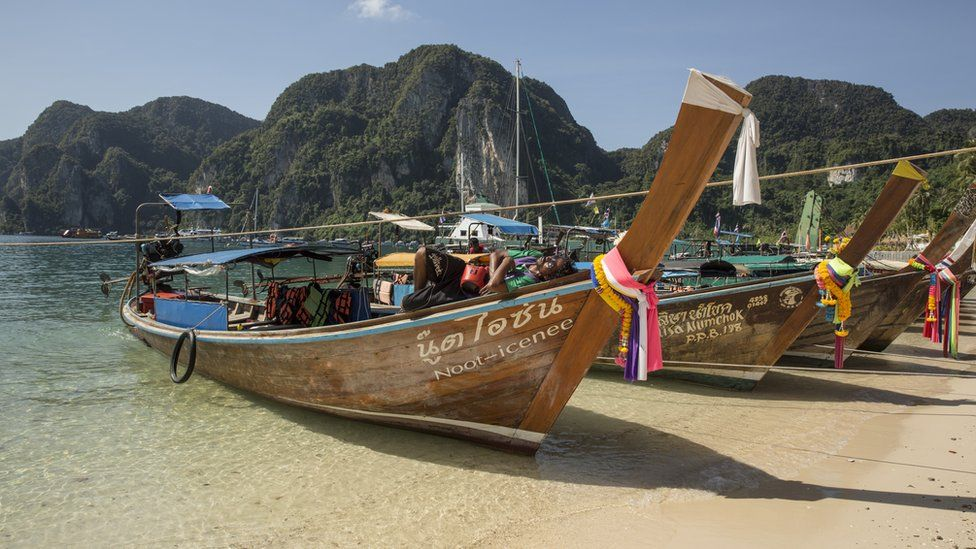 Boats against the backdrop of vegetation-covered mountains on Phi Phi Island in December 2005
