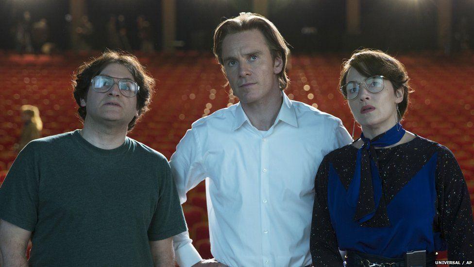 Michael Stuhlbarg as Andy Hertzfeld, Michael Fassbender as Steve Jobs and Kate Winslet as Joanna Hoffman in the movie Steve Jobs