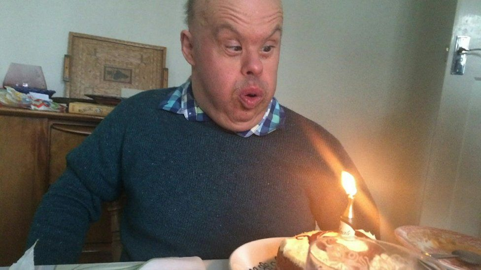 Giuseppe Ulleri blowing out a candle on a cake