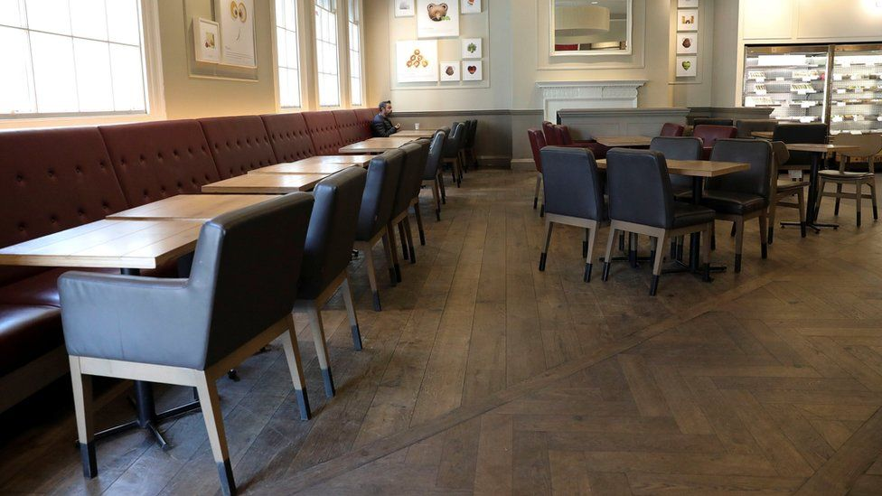 One man sits alone in an empty cafe