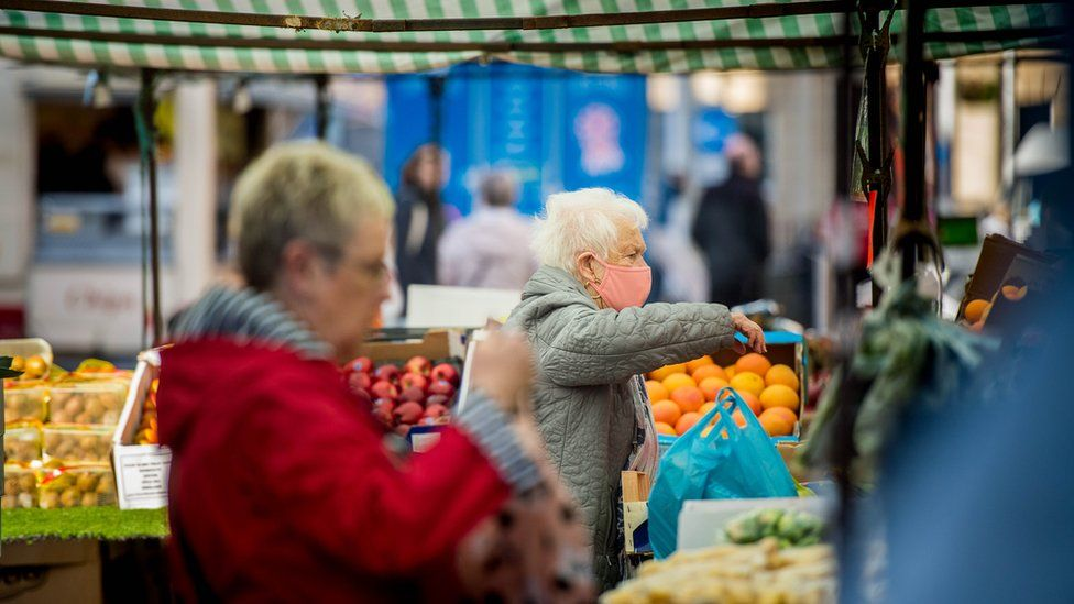 Shoppers at a fruit and veg stall