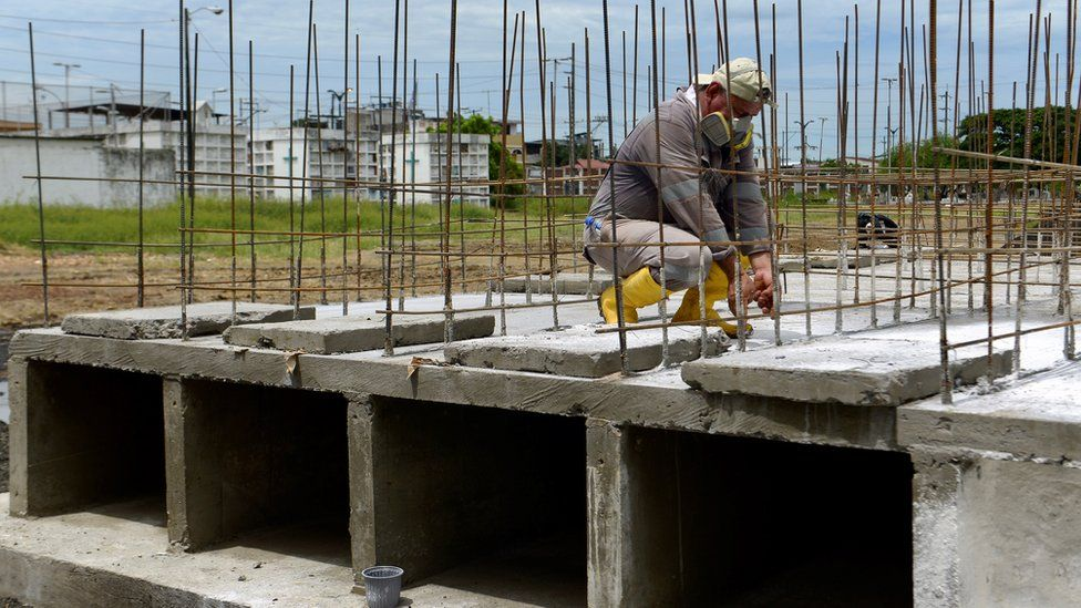 A man works making tombs for victims of Covid-19 at Angel Maria Canales cemetery in Guayaquil, Ecuador, 15 April 2020