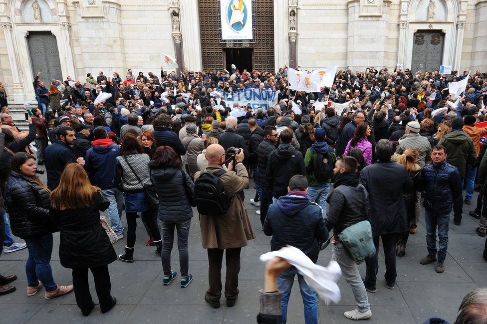 Protesters outside the cathedral in Naples, 5 March