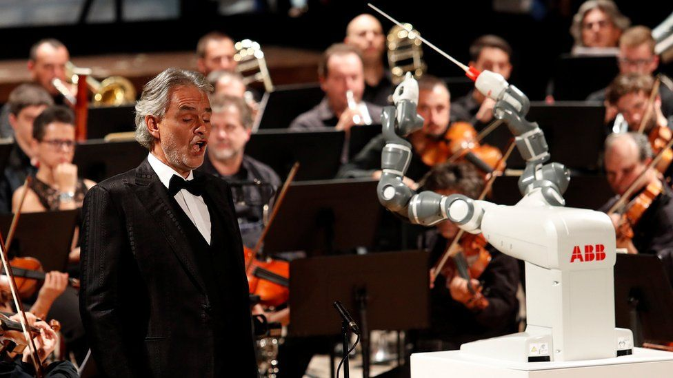 The robot YuMi conducts the Lucca Philharmonic Orchestra with Andrea Bocelli in Pisa.