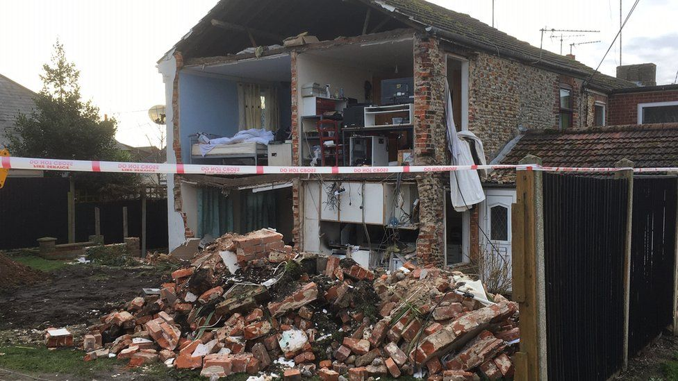House wall collapsed
