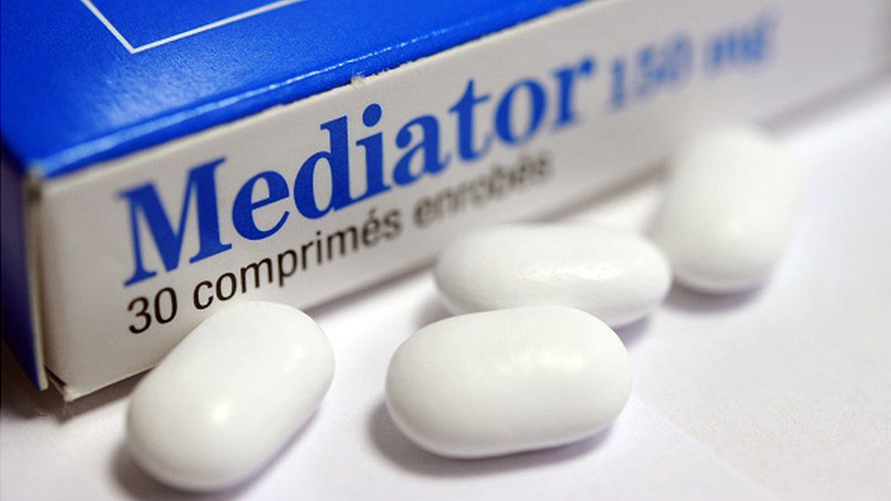 A box and pills for the weight loss drug Mediator