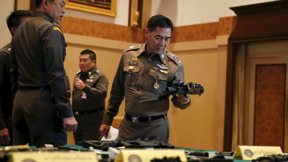 National police chief Chakthip Chaijinda inspecting alleged evidence at Bangkok news conference