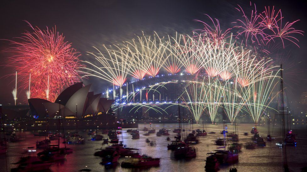 Fireworks explode over the harbour and the Sydney Harbour Bridge landmark during New Year's celebrations in Sydney, Australia, 1 January 2019