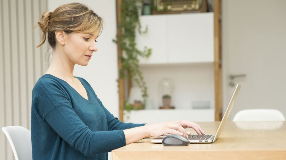 Generic image of a woman working on a laptop at home
