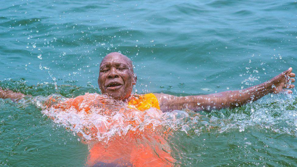 Lifeguard Stephen Boboly swimming in Lagos, Nigeria