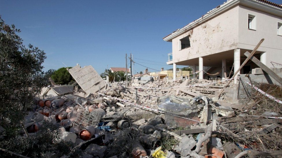 Image shows destroyed remains of a house, thought to be a bomb-making centre for the group.