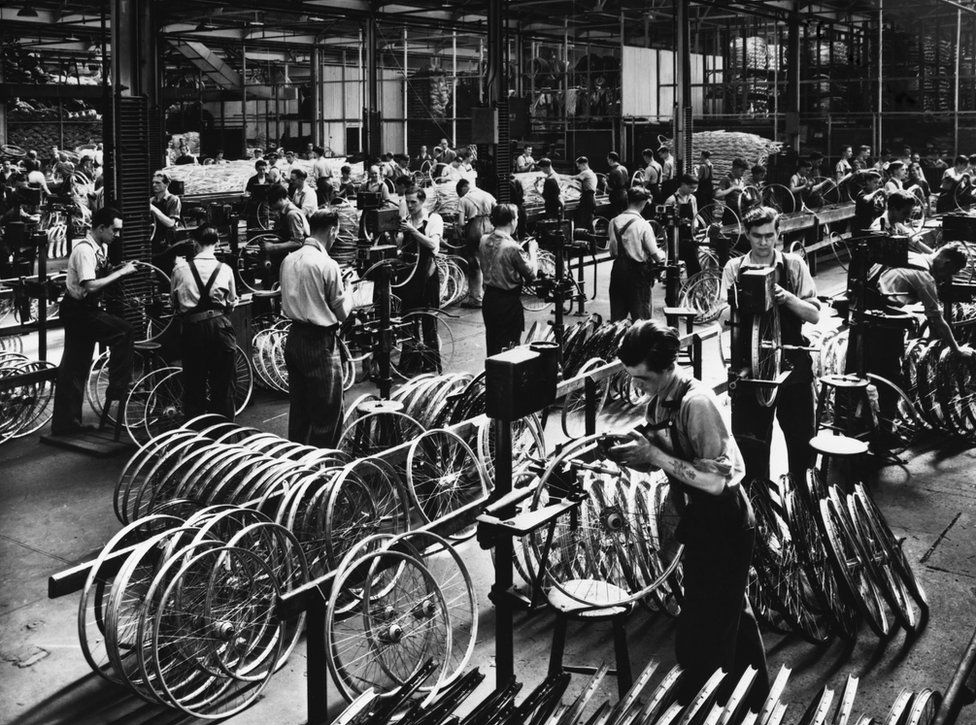 Workers assembling bicycles inside a Raleigh factory in the early 1900s