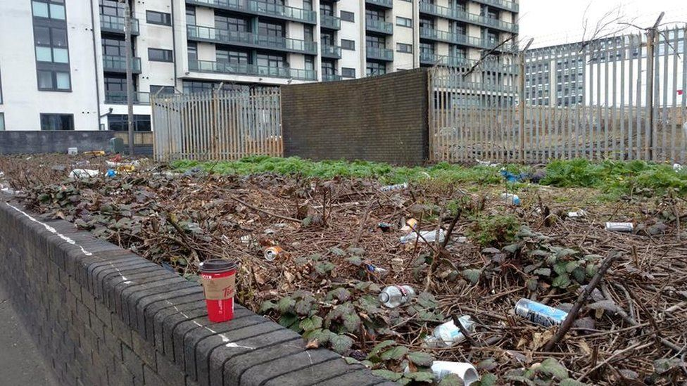rubbish in grounds of new homes