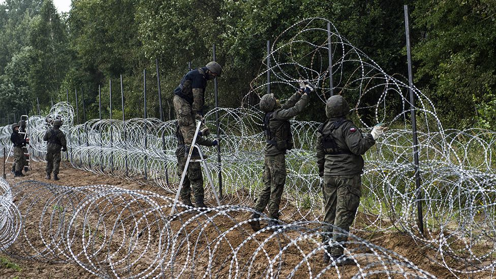 Polish soldiers are seen building a fence along the border with Belarus - 26 August 2021