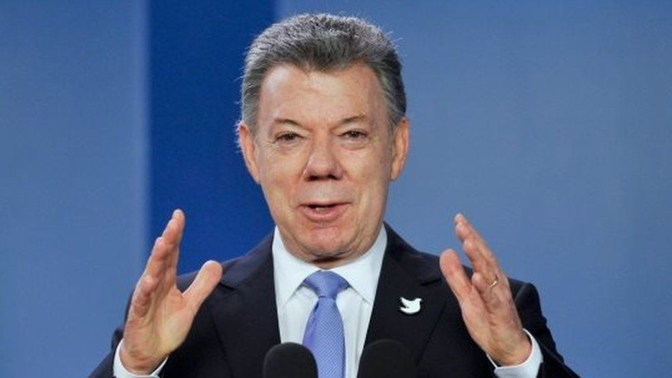 Colombian President Juan Manuel Santos gestures during a press conference at Narino presidential Palace in Bogota, on June 15, 2016.