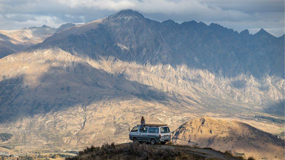 Campervan overlooking mountains.
