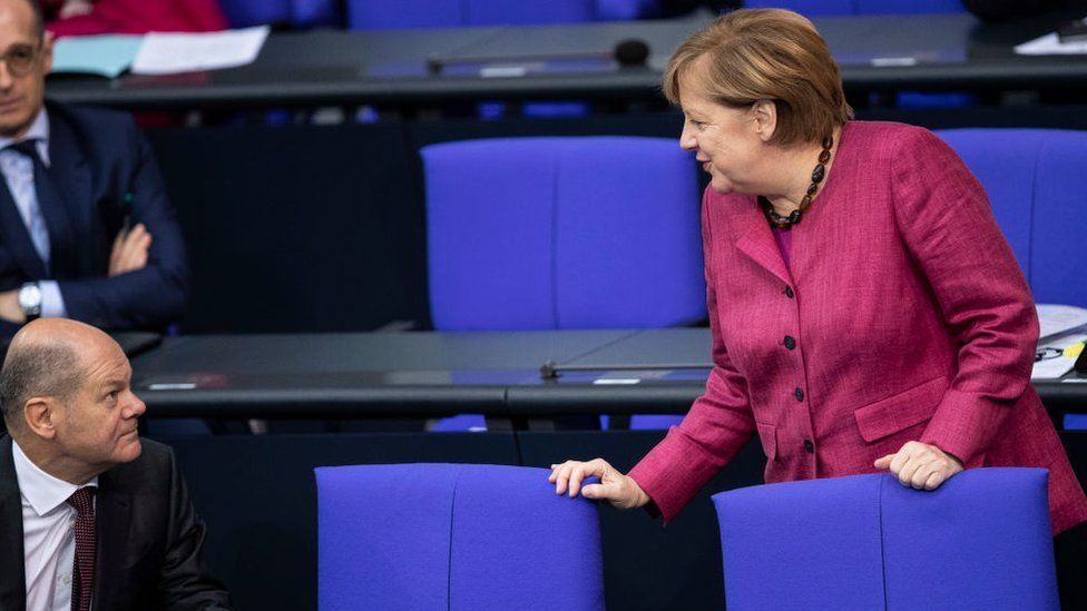 German Chancellor Angela Merkel talks to German Finance Minister and Vice Chancellor Olaf Scholz in October 2020