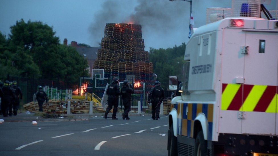 Police officers in riot gear at the Bloomfield walkway bonfire