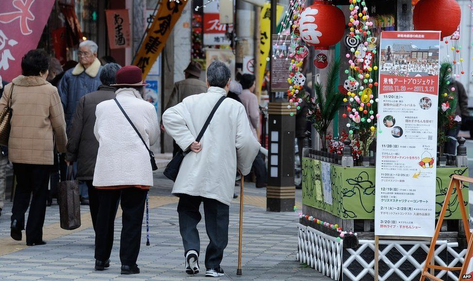 Elderly people walking in a street in Tokyo