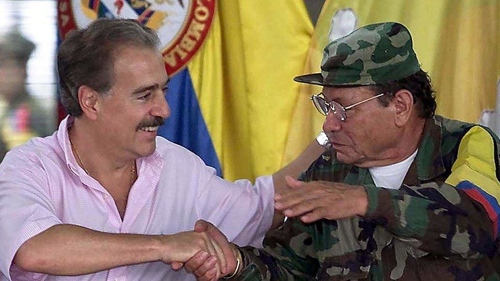 Colombian President Andres Pastrana shakes hands with former FARC leader, Manuel Marulanda Velez