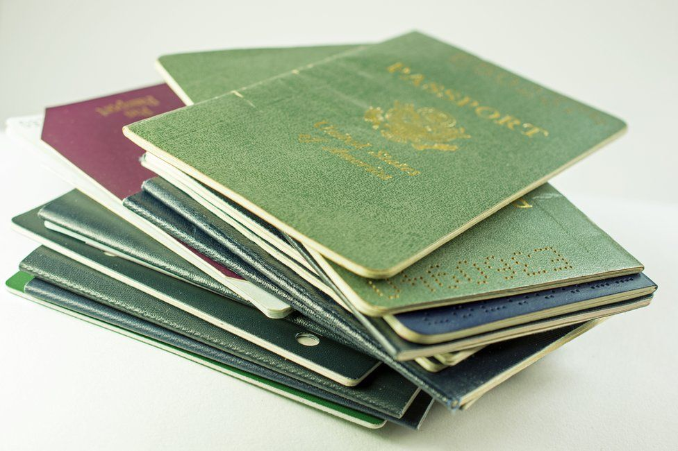A pile of passports from different countries