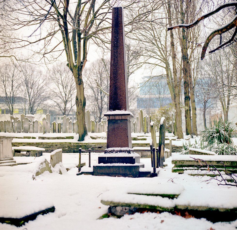 Brady Street in the mid-winter. The Hyman Hurwitz monument with a distant outline of the new Royal London Hospital