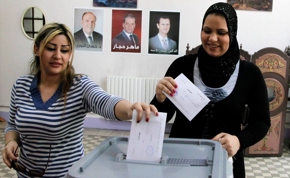 Women from Damascus vote in the June 2014 presidential election in Syria