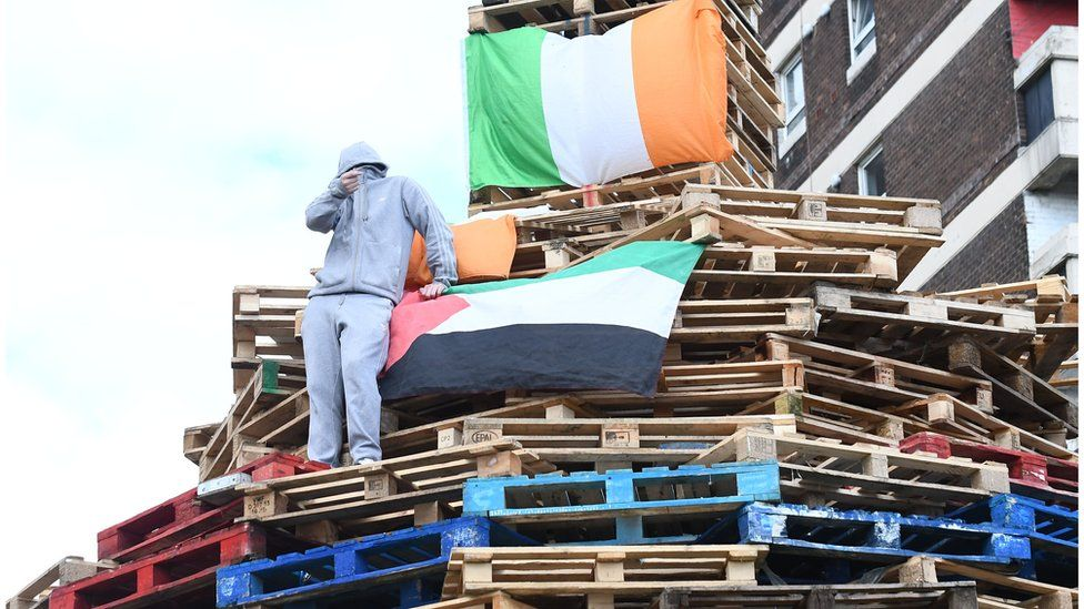 Youths rebuild bonfire close to New Lodge flats in north Belfast, Tuesday 8 August 2017