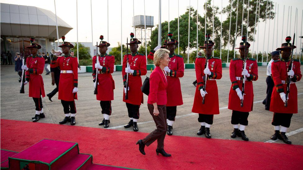 A military honours guards stand at attention at the Airport in Abuja, Nigeria, as German Minister of Defense Ursula von der Leyen walks past.