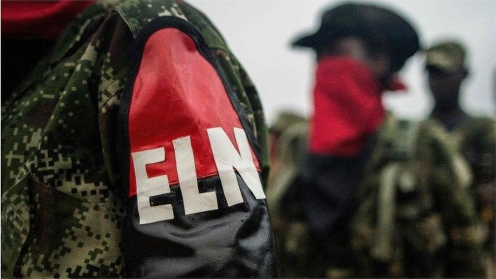 "This file photo taken on November 19, 2017 shows members of the ""Omar Gomez"" Western War Front of the National Liberation Army (ELN) rebel group lining up in their camp on the banks of the San Juan River, Choco department, Colombia"