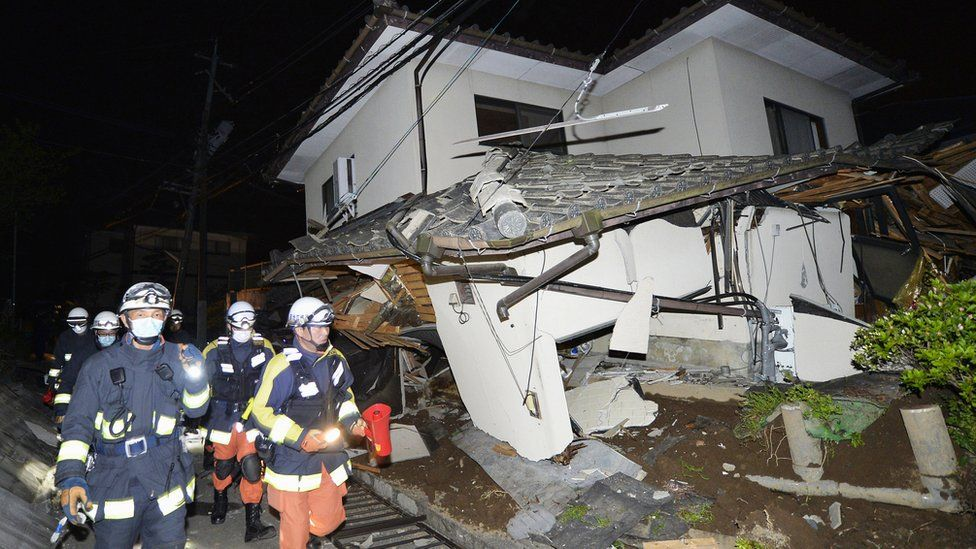 Firefighters check damage to collapsed house in Mashiki, near Kumamoto city. 15 April 2016