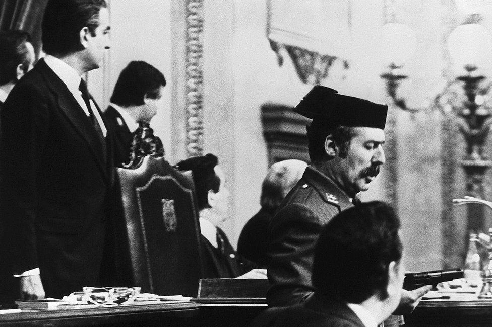 Lt-Col Antonio Tejero de Molina (C) brandishes his pistol in the Spanish parliament, 23 February 1981