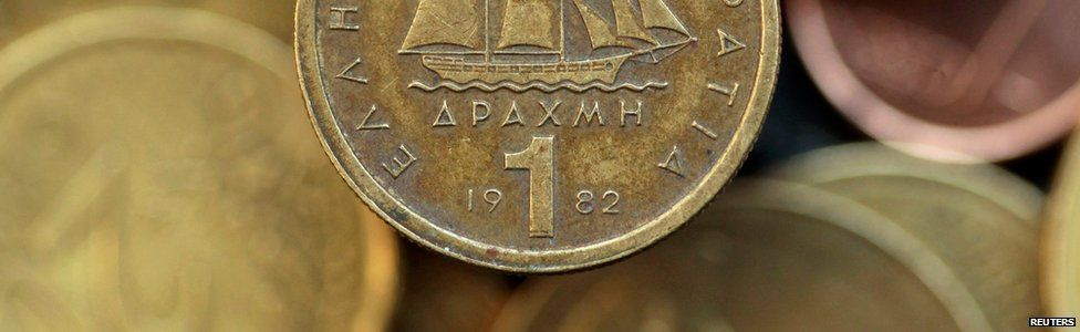 A drachma coin is seen on display in this photo illustration taken in Athens in this May 9, 2012