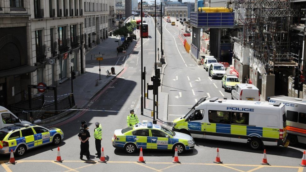 Police cordon an area near London Bridge station after an attack in the capital, 4 June 2017