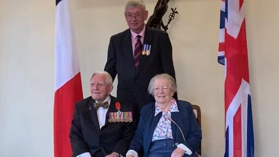 Dennis Roy Cooper with wife Mary and Nick Bates from the Armed Forces charity SSAFA
