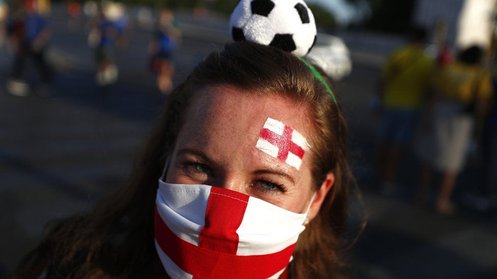 An England supporter poses for a phot in Rome