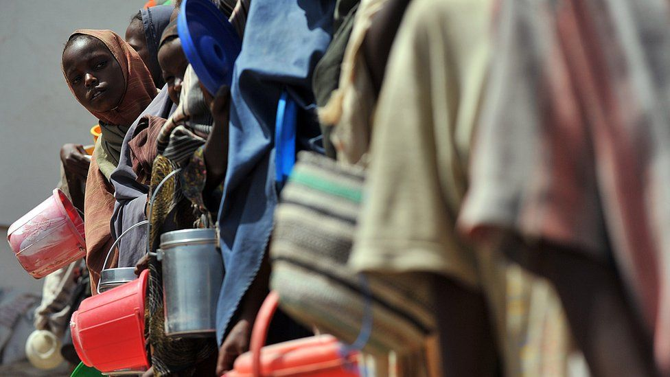 Somalis collecting water at a camp in 2012