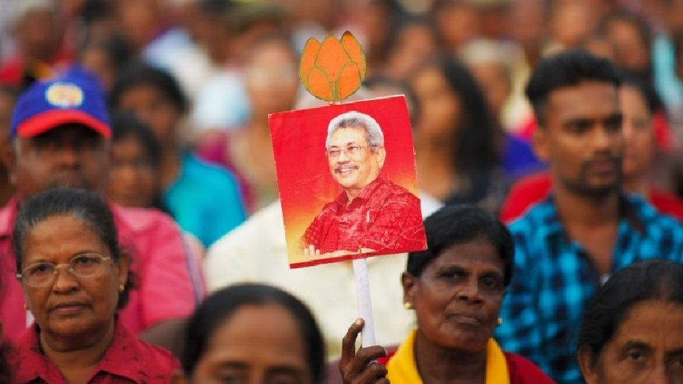 Supporters of Sri Lanka Podujana Peramuna (SLPP) party presidential candidate Gotabhaya Rajapaksa attend a campaign rally in Homagama on November 13, 2019