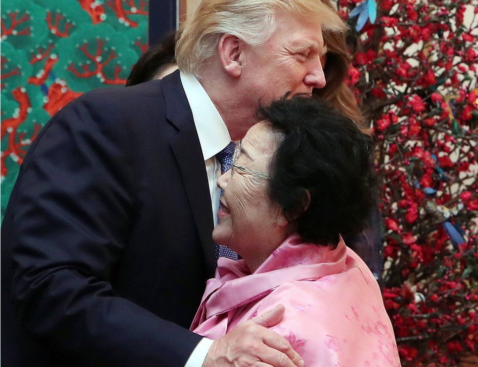 """US President Donald J. Trump (L) embraces Lee Yong-soo, a former """"comfort woman"""" who was forced into sexual slavery by Japan's military during World War II, at a state banquet hosted by South Korean President Moon Jae-in at the presidential office Cheong Wa Dae in Seoul, South Korea, 7 November 2017."""