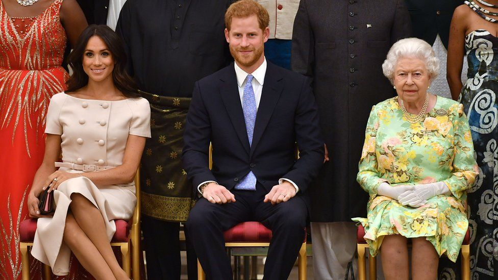 Meghan, Duchess of Sussex, Britain's Prince Harry, Duke of Sussex and Britain's Queen Elizabeth II pose for a picture during the Queen's Young Leaders Awards Ceremony on June 26, 2018