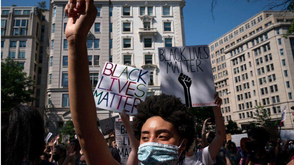Demonstrators peacefully protest outside of Trump International Hotel Washington