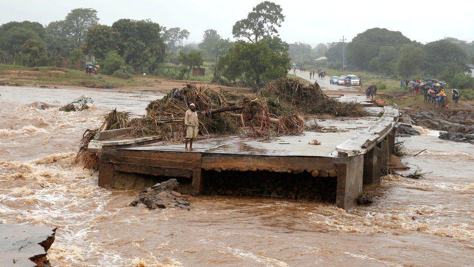 A man looks at a washed away bridge along Umvumvu river following Cyclone Idai in Chimanimani, Zimbabwe March 18, 2019