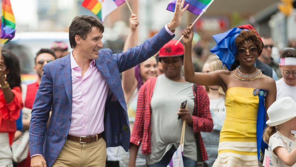 Prime Minister Justin Trudeau waves to the crowd as he marches in the Pride Parade in Toronto, June 25, 2017