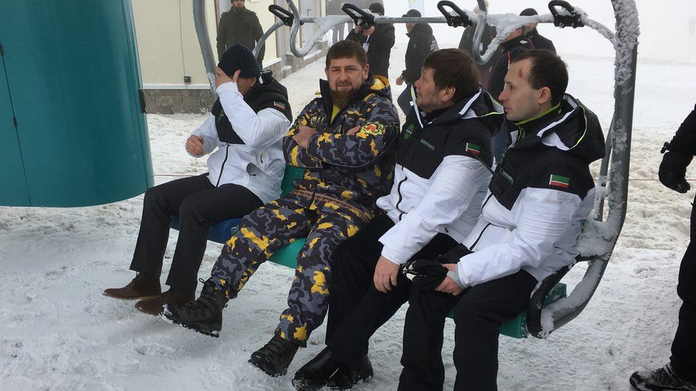 Ramzan Kadyrov and three others sit in a chairlift of the ski resort