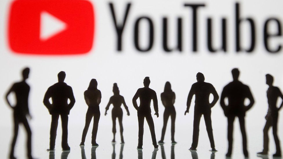 YouTube logo with people in silhouette