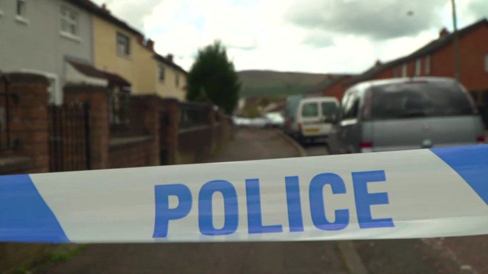 Police tape cordoning off the scene of a shooting on Silverstream Road in north Belfast
