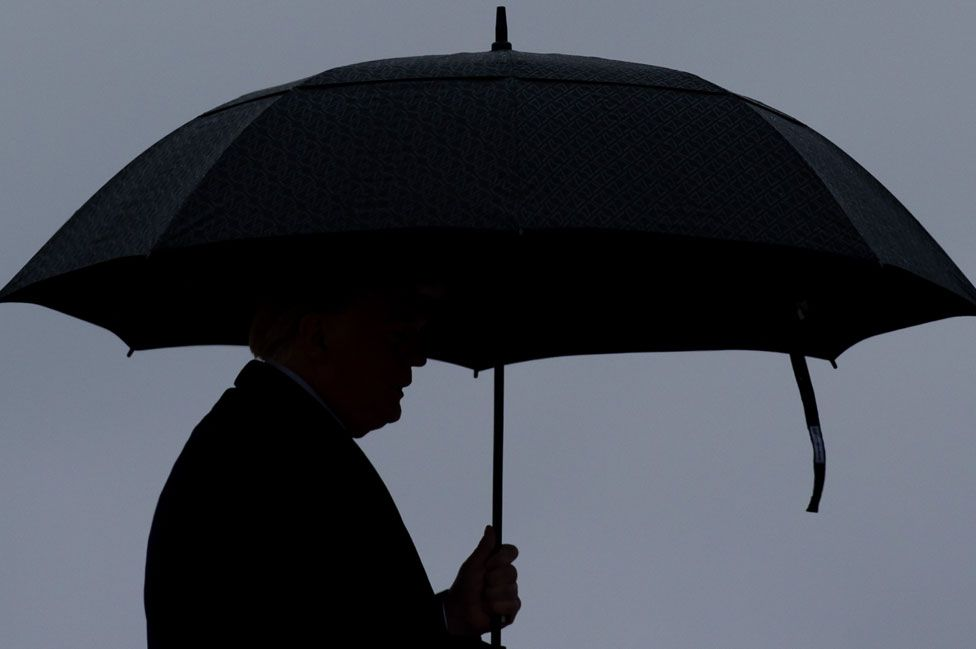 Trump under an umbrella